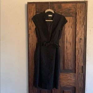 A black button-down tie front dress